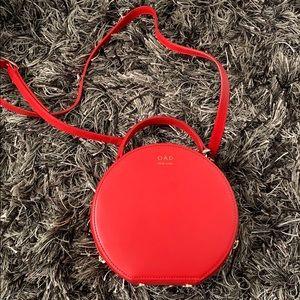 OAD New York red mini circle peddled leather bag